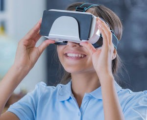 Girl looking into virtual reality headset.